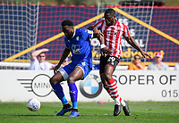 Tranmere Rovers' Emmanuel Monthe under pressure from Lincoln City's John Akinde<br /> <br /> Photographer Chris Vaughan/CameraSport<br /> <br /> The EFL Sky Bet League Two - Lincoln City v Tranmere Rovers - Monday 22nd April 2019 - Sincil Bank - Lincoln<br /> <br /> World Copyright © 2019 CameraSport. All rights reserved. 43 Linden Ave. Countesthorpe. Leicester. England. LE8 5PG - Tel: +44 (0) 116 277 4147 - admin@camerasport.com - www.camerasport.com