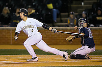 Stuart Fairchild (4) of the Wake Forest Demon Deacons hits a sacrifice fly against the Georgetown Hoyas at David F. Couch Ballpark on February 19, 2016 in Winston-Salem, North Carolina.  The Demon Deacons defeated the Hoyas 3-1.  (Brian Westerholt/Four Seam Images)