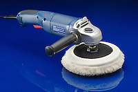 Electric power waxer and polisher on shiny blue surface