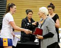 Dame Lois Muir presents Otago's Gina Crampton with the Lion Foundation Netball Championship cup after defeating Hamilton, day five, MoreFM Arena, Dunedin, New Zealand, Friday, October 04, 2013. Credit: Dianne Manson/©MBPHOTO /Michael Bradley Photography.