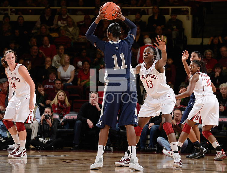 STANFORD, CA - DECEMBER 28: Chiney Ogwumike (13), Nnemkadi Ogwumike (30), and Kayla Pedersen (14) of Stanford women's basketball on defense in a game against Xavier on December 28, 2010 at Maples Pavilion in Stanford, California.  Stanford topped Xavier, 89-52.