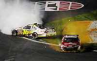 Oct. 17, 2009; Concord, NC, USA; NASCAR Sprint Cup Series driver Greg Biffle (16) spins as Mike Bliss (71) drives through the grass during the NASCAR Banking 500 at Lowes Motor Speedway. Mandatory Credit: Mark J. Rebilas-