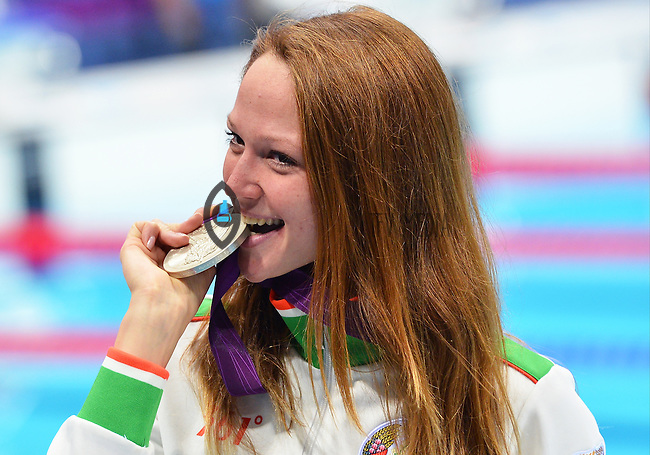 August 04, 2012..Aliaksandra Herasimenia bites on Women's 50m Freestyle Silver Medal at the Aquatics Center on day eight of 2012 Olympic Games in London, United Kingdom.