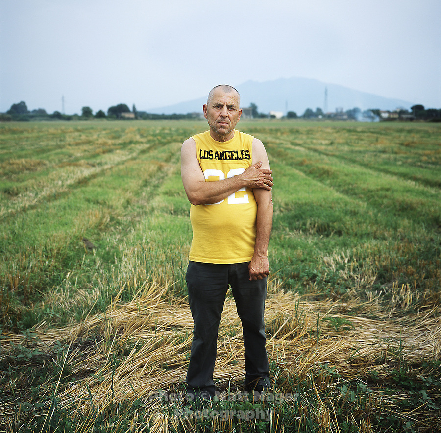 Mario Cannavacciuolo (cq), a sheep herder, stands on his abandoned land in the country side outside Acerra, Italy, Thursday, July 1, 2010. The Cannavacciuolo family has been destroyed by illegal toxic waste disposal and a government sponsored garbage incinerator which was constructed adjacent to their land. His flock of sheep, of about 3000, died due to dioxin contamination. His brother, Enzo Cannavacciuolo (cq), died shortly after, and tests show his body contained levels of dioxin, purins, and PCBs 30 times the amount allowed by the World Health Organization. The Cannavacciuolo family no longer earns money off the land which has been in their family for generations...PHOTO/ MATT NAGER