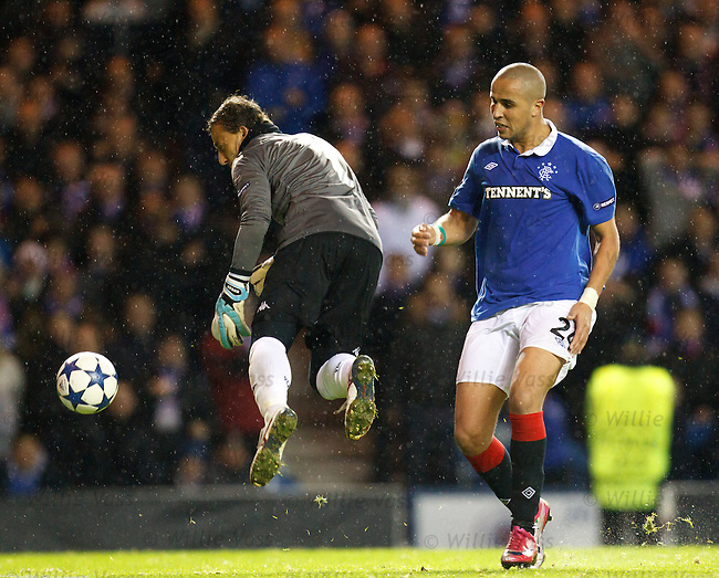 Madjid Bougherra dinks the ball past Cesar Sanchez but it trundles agonisingly past