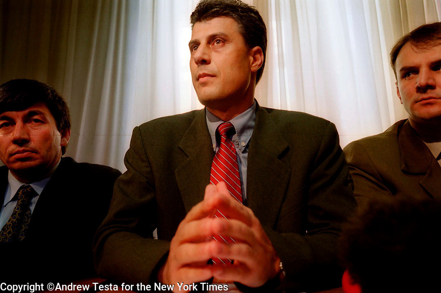 KOSOVO. Pristina. 30/10/2000..Hashim Thaci (centre) ex Commander of the Kosovo Liberation Army and leader of the PDK at a press conference in pristina..©Andrew Testa for the New York Times