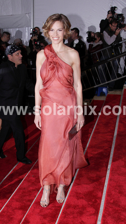 "**ALL ROUND PICTURES FROM SOLARPIX.COM**.**SYNDICATION RIGHTS FOR UK, AUSTRALIA, DENMARK, PORTUGAL, S. AFRICA, SPAIN & DUBAI (U.A.E) ONLY**.Arrivals at ""The Model as Muse: Embodying Fashion"" Costume Institute Gala at The Metropolitan Museum of Art, New York City, NY, USA.This pic:  Hilary Swank.JOB REF:  8957   PHZ/WILD1    DATE:  04.05.09.**MUST CREDIT SOLARPIX.COM OR DOUBLE FEE WILL BE CHARGED**.**ONLINE USAGE FEE GBP 50.00 PER PICTURE - NOTIFICATION OF USAGE TO PHOTO @ SOLARPIX.COM**.**CALL SOLARPIX : +34 952 811 768 or LOW RATE FROM UK 0844 617 7637**"