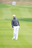 Marc Warren (SCO) chips onto the 13th green during Sunday's Final Round of the 2014 BMW Masters held at Lake Malaren, Shanghai, China. 2nd November 2014.<br /> Picture: Eoin Clarke www.golffile.ie