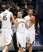 Justin Cobbs of California gives high fives with David Kravish of California during the game at Haas Pavilion in Berkeley, California on November 13th, 2011.  California defeated George Washington, 81-54.