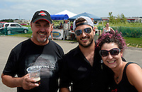 Wisconsin Brewing Company president, Carl Nolen, sales leader, Jesse Vogel, and Milwaukee rep, Kathryn Schulze, celebrate the creation of Depth Charge Scotch Ale on Sunday, July 12, 2015, in Verona, Wisconsin.