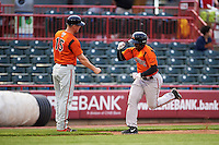 Bowie Baysox designated hitter Quincy Latimore (22) is congratulated by coach Shawn McGill (15) as he rounds the bases after hitting a home run during a game against the Erie SeaWolves on May 12, 2016 at Jerry Uht Park in Erie, Pennsylvania.  Bowie defeated Erie 6-5.  (Mike Janes/Four Seam Images)