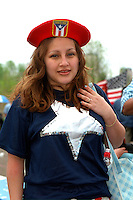 Parade Participant age 16 with Puerto Rican beret at Cinco de Mayo Festival.  St Paul Minnesota USA