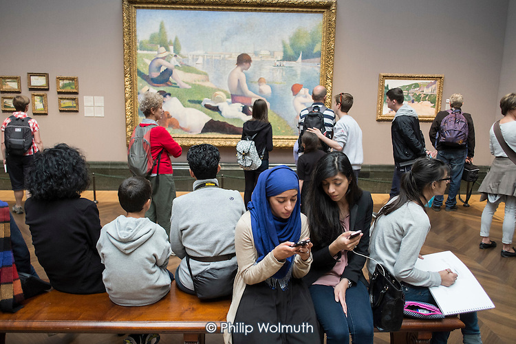 Visitors to the National Gallery in London, following the lifting of restrictions on the use of smartphones and cameras.