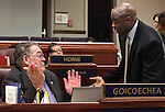 Nevada Assembly Minority Leader Pete Goicoechea, R-Eureka, left, and Assemblyman Kelvin Atkinson, D-North Las Vegas, talk on the Assembly floor on April 18, 2011, at the Legislature in Carson City, Nev. .Photo by Cathleen Allison