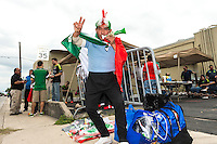 Street vendor Angel Pena cheers before an international friendly, Wednesday, April 15, 2015 in San Antonio, Tex. (Mo Khursheed/TFV Media via AP Images)