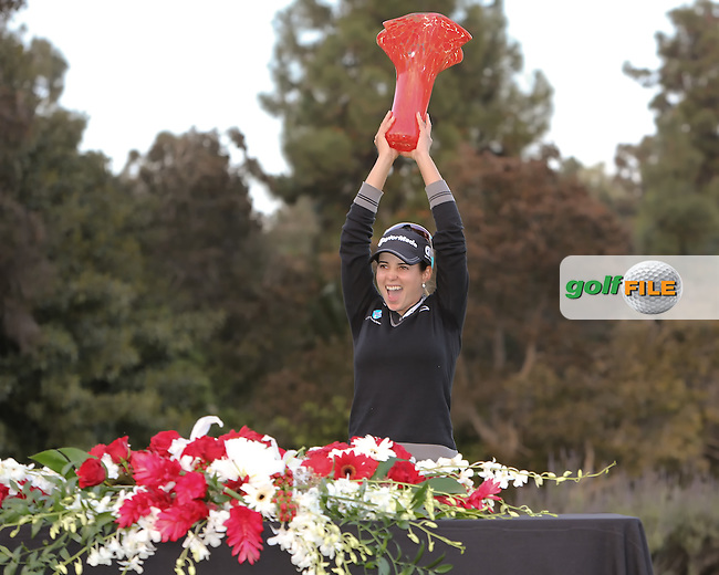 24 MAR 13  Beatriz Ricari holds the trophy high on the 18th green with the trophy  at the conclusion of Sundays Playoff at the Final Round of The KIA Classic at Aviara Golf Club in Carlsbad, California. (photo:  kenneth e.dennis / kendennisphoto.com) www.golffile.ie