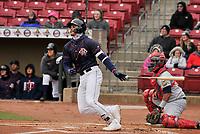 Cedar Rapids Kernels catcher Ben Rodriquez (23) swings at a pitch against the Burlington Bees at Veterans Memorial Stadium on April 14, 2019 in Cedar Rapids, Iowa.  The Bees won 6-2.  (Dennis Hubbard/Four Seam Images)