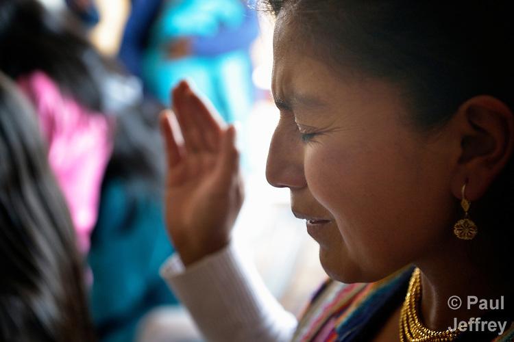 Pastor Blanca Viracocha prays during worship at the Methodist Church in Romerillos, Ecuador.