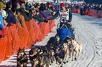Travis Beals gives a high-five to spectators on Willow Lake during the Restart of the 2016 Iditarod in Willow, Alaska.  March 06, 2016.