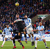 17th March 2018, The John Smiths Stadium, Huddersfield, England; EPL Premier League football, Huddersfield Town versus Crystal Palace; James McArthur of Crystal Palace and Christopher Schindler of Huddersfield Town compete for a header with Steve Mounie of Huddersfield Town close by