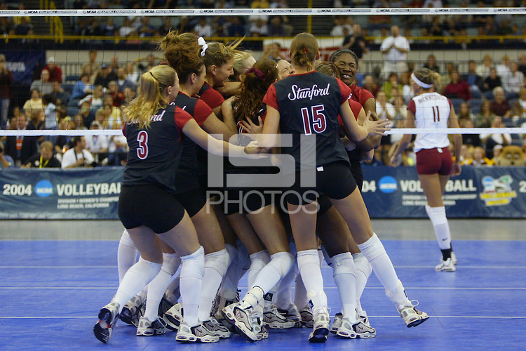 18 December 2004: The Stanford team celebrates match point during Stanford's  30-23, 30-27, 30-21 victory over Minnesota in the 2004 NCAA Women's Volleyball National Championships in Long Beach, CA. Stanford won their sixth women's volleyball title in school history. Pictured are Kirsten Hornbeak, Katie Goldhahn, Liz Suiter, Michelle Mellard, and Ogonna Nnamani<br />