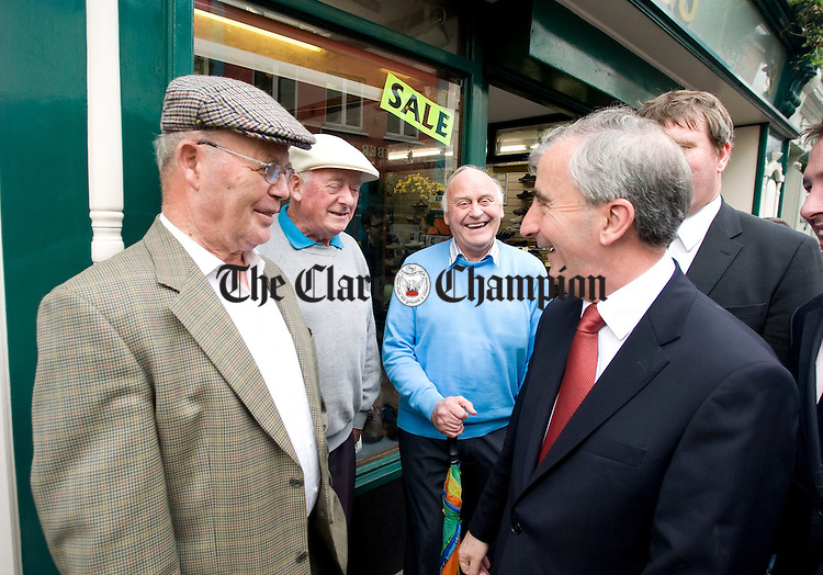 Gay Mitchell, Fine Gael presidential candidate, shares a joke with John Cahir, Tony Morgan and Michael Carey on O' Connell Street during his recent visit to Ennis. Photograph b Declan Monaghan