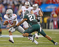 Ohio State Buckeyes quarterback Braxton Miller (5) gets past Michigan State Spartans safety Kurtis Drummond (27) for a gain in the second half  at Lucas Oil Stadium in Indianapolis, Ohio on December 7, 2013.  (Chris Russell/Dispatch Photo)