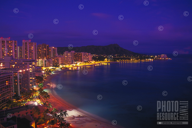 View of Waikiki Beach with Diamond head and hotels at dusk, Oahu