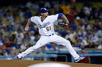 Josh Beckett #61 of the Los Angeles Dodgers pitches against the St.Louis Cardinals at Dodger Stadium on September 13, 2012 in Los Angeles, California. St.Louis defeated Los Angeles 2-1. (Larry Goren/Four Seam Images)
