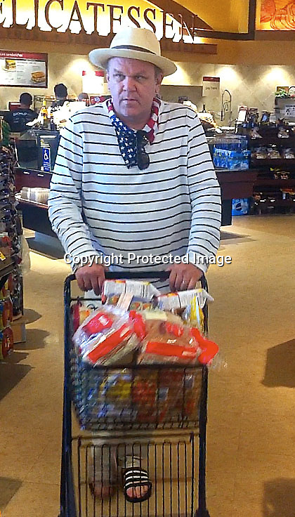 July 4th 2011  Exclusive ..Malibu California .John C. Reilly grocery shopping at Safeway supermarket. John was wearing a red white & blue scarf to celebrate the 4th of July ...AbilityFilms@yahoo.com.805-427-3519.      www.AbilityFilms.com.