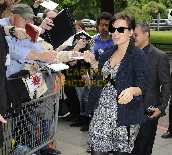 LILY ALLEN.The Ivor Novello Awards 2011, Grosvenor House Hotel, London, England..May 19th, 2011.half length navy blue jacket grey gray dress print sunglasses shades profile fans crowd.CAP/CAN.©Can Nguyen/Capital Pictures.