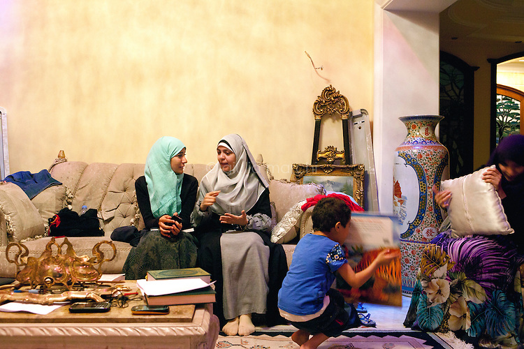 Egypt / Cairo / 9.7.2012 / Muslim Sisters of the Nasr City&rsquo;s group talk in a weekly meeting where young women meet an older Sister to discuss about the role of religion. Here, in Rhada's apartment in Nasr City. Cairo, July 9th 2012. Egypt.<br /> <br /> &copy; Giulia Marchi