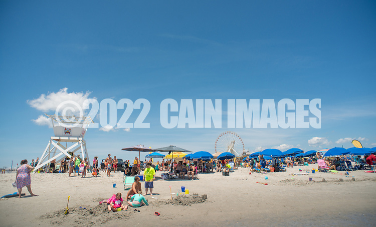 The group gathers on the beach during the 11th annual 21 Down Beach Day Monday, July 15, 2019 at Schellenger Street beach in Wildwood, New Jersey. Every summer, the Wildwood Beach Patrol opens Lincoln Ave Beach for kids with down syndrome and their families for 21 Down Beach Day. Often, kids with down syndrome aren't comfortable in the ocean. Their parents can't just relax and watch them frolic. But on July 15th, the kids swim with seasoned Wildwood lifeguards on soft-top paddle boards. (Photo by William Thomas Cain / CAIN IMAGES)