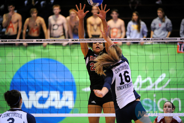 04 DEC 2010:  Melissa Vanderhall (24) of Tampa attempts to block a spike from Emily Palkert (16) of Concordia St. Paul during the Division II Women's Volleyball Championship held at Knights Hall on the Bellarmine campus in Louisville, KY.  Josh Duplechian/NCAA Photos