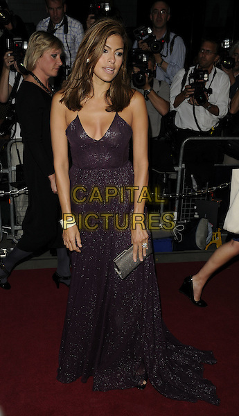 EVA MENDES.The GQ Men Of The Year Awards 2009 held at the Royal Opera House, Covent Garden, London, England. .8th September 2009 .full length purple aubergine mendes long maxi dress silver grey gray clutch bag white bracelet .CAP/CAN.©Can Nguyen/Capital Pictures.