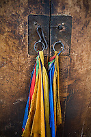 Colorful flags hang from a temple door in the Labrang Monastery in Xiahe, Gansu, China.  Xiahe, home of the Labrang Monastery, is an important site for Tibetan Buddhists.  The population of the town is divided between ethnic Tibetans, Muslims, and Han Chinese.