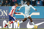 Atletico de Madrid's Jose Maria Gimenez (l) and Granada's Success Ajayi Isaac during La Liga match.January 18,2015. (ALTERPHOTOS/Acero)