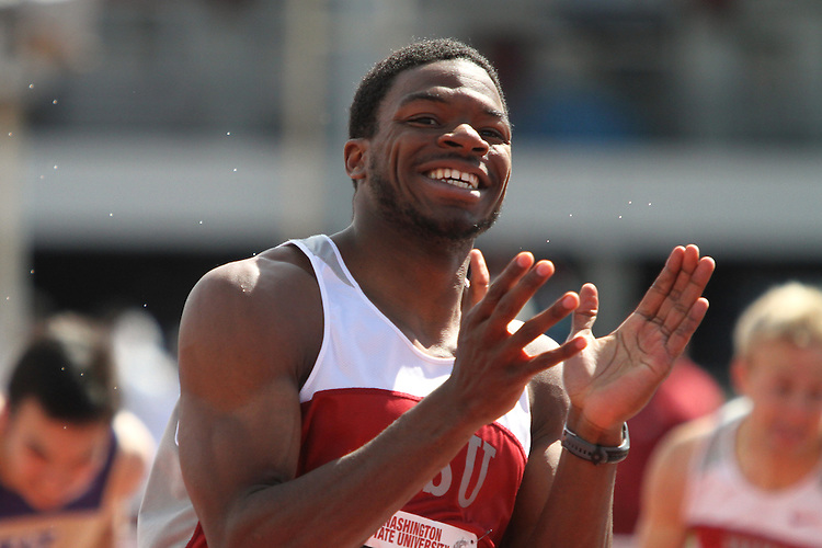 Jeshua Anderson, Washington State junior, crosses the finish line after winning the 110 meter hurdles final in the rainy and inclement weather during the Cougars dual track and field meet with arch-rival Washington at Mooberry Track at Washington State University in Pullman, Washington, on May 1, 2010.