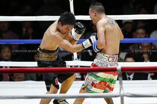 L to R) Takashi Miura (JPN), Dante Jardon (MEX), DECEMBER 31, 2013 - Boxing : Takashi Miura of Japan hits against Dante Jardon of Mexico during the WBC Super Fry weight title bout at Ota-City General Gymnasium, Tokyo, Japan. (Photo by AFLO SPORT) [0006]