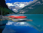 Banff National Park, AT   Canada              Boat dock on lake Louise with Mount Victoria and Victoria Glacier in the distance