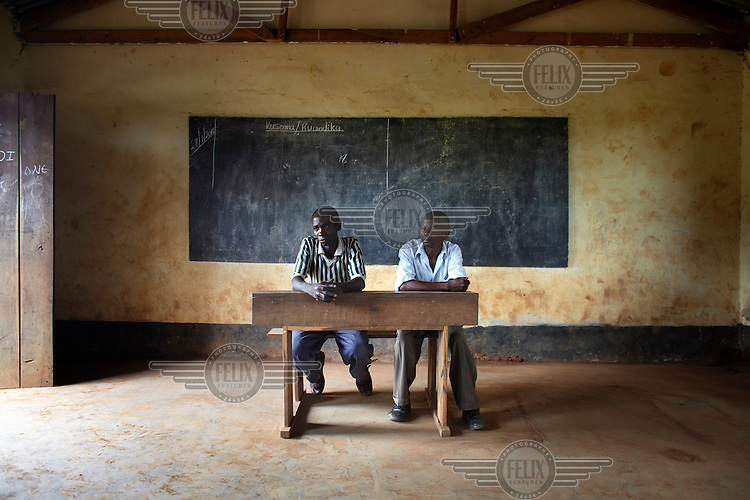 Chairperson of Miyuyu village, Issa Omari, 36, and Village Executive Officer, Mohamed Mahimu, 43, hold a meeting in Miyuyu Primary School. In Tanzania the village chairperson is elected to deal with local with political issues. The V.E.O is the lowest level of government, and is responsible for issues such as collecting revenues, settling disputes and supervising projects at village level.