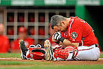 21 June 2008: Washington Nationals' catcher Paul Lo Duca shows signs of pain after a home plate collision with Marlon Byrd in the first inning during a game against the Texas Rangers at Nationals Park in Washington, DC. The Rangers defeated the Nationals 13-3 in the second game of their 3-game inter-league series...Mandatory Photo Credit: Ed Wolfstein Photo