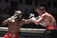 Ryan Walker (red shorts) defeats Michael Horobin during a Boxing Show at York Hall on 8th September 2018