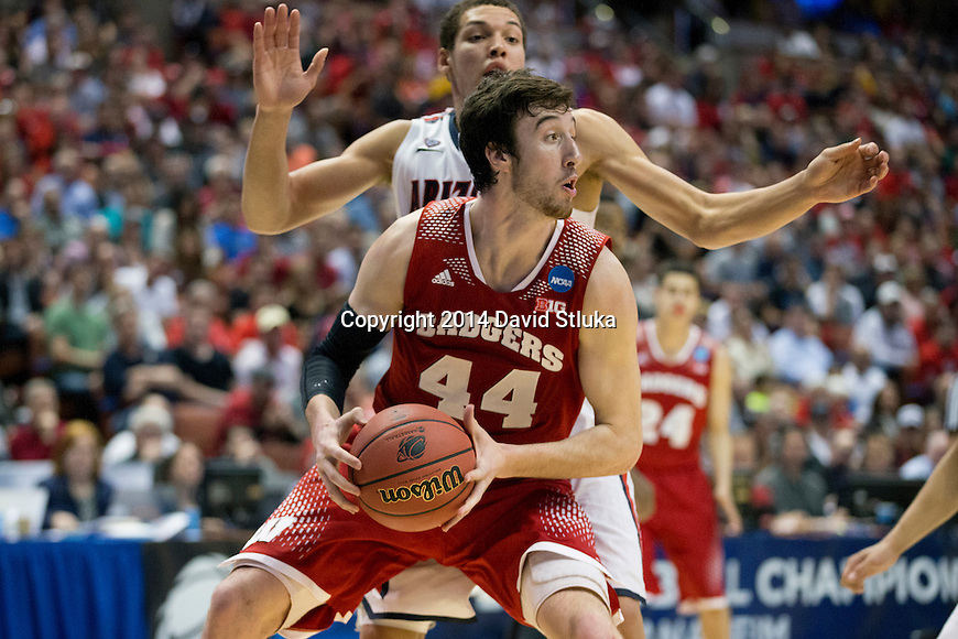Wisconsin Badgers center Frank Kaminsky (44) handles the ball during the Western Regional Final NCAA college basketball tournament game against the Arizona Wildcats Saturday, March 29, 2014 in Anaheim, California. The Badgers won 64-63 (OT). (Photo by David Stluka)