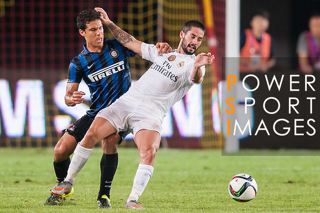 (R) Hernanes of FC Internazionale Milano competes for the ball with (R) Isco of Real Madrid CF during the FC Internazionale Milano vs Real Madrid  as part of the International Champions Cup 2015 at the Tianhe Sports Centre on 27 July 2015 in Guangzhou, China. Photo by Hendrik Frank / Power Sport Images