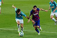16th July 2020; Camp Nou, Barcelona, Catalonia, Spain; La Liga Football, Barcelona versus Osasuna;  Leo Messi and Nacho Vidal challenge for the ball on the edge of the box