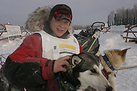 Sunday February 26, 2006 Willow, Alaska.  First place finisher Michael Degerland poses at the finishline  with his lead dogs General (L) and Jim (r) after finishing the Junior Iditarod Sled Dog Race in 11  hours  and 15 minutes.