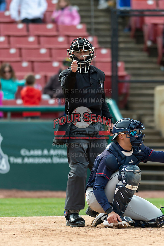 Umpire Clay Williams calls a strike behind catcher Ben Rodriguez (23) during a Midwest League game between the Kane County Cougars and Cedar Rapids Kernels at Northwestern Medicine Field on April 28, 2019 in Geneva, Illinois. Kane County defeated Cedar Rapids 3-2 in game one of a doubleheader. (Zachary Lucy/Four Seam Images)