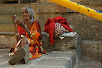 Outskirts of Mumbai, streetscene, an old women in the afternoon sun, Mumbai, India