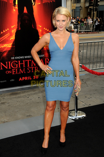 "NICKY WHELAN .""A Nightmare On Elm Street"" Los Angeles Premiere held at Grauman's Chinese Theatre, Hollywood, California, USA, 27th April 2010..full length hand on hip blue smiling dress sleeveless black shoes Herve Leger bandage dress body con .CAP/ADM/BP.©Byron Purvis/AdMedia/Capital Pictures."
